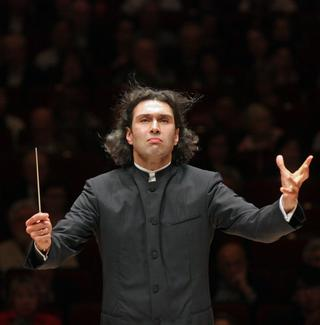 Vladimir Jurowski leading the London Philharmonic Orchestra in Shostakovich's Symphony No. 8 at Carnegie Hall