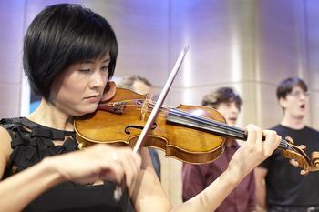 Playing the part of Einstein, violinist Jennifer Koh performs 'Knee Play 2' from <em>Einstein on the Beach</em>.