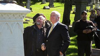 Sculptor Giancarlo Biagi and Green-Wood Cemetery president Richard J. Moylan look at the 'Angel of Music' Statue
