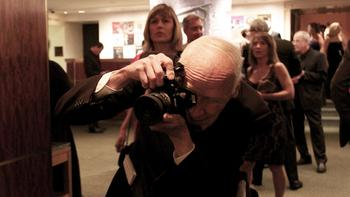 Longtime New York Times fashion photographer Bill Cunningham doing his thing at the Carnegie Hall season opener gala.