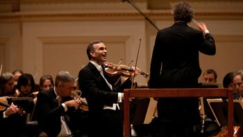 Violinist Gil Shaham performs Brahm's Violin Concerto with Conductor Franz Welser-Most and the Cleveland Orchestra at Carnegie Hall on May 23, 2012.