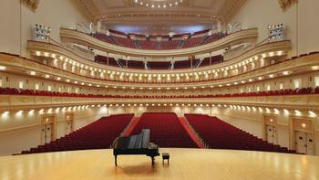 An iconic image of classical music: The Carnegie Hall stage set for a piano recital.