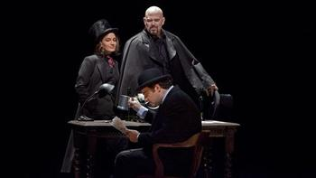 """A scene from Act II (Antonia act) of Offenbach's """"Les Contes d'Hoffmann""""  with Joseph Calleja as Hoffmann (seated), Kate Lindsey as Nicklausse, and Alan Held as Dr. Miracle."""