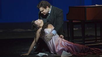 "Anna Netrebko as Antonia and Joseph Calleja as Hoffmann in Offenbach's ""Les Contes d'Hoffmann."""