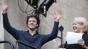 The Knights conductor and co-founder Eric Jacobsen receives a loud welcome as he joins WQXR host Midge Woolsey.