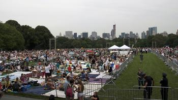 Central Park's Great Lawn fills up with picnickers.