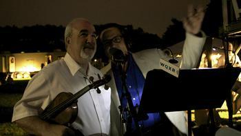Concertmaster Glenn Dicterow with WQXR host Elliott Forrest during intermission.