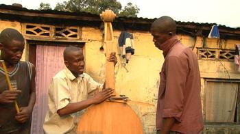Orchestra manager Albert Nlandu Matubanza making a double bass