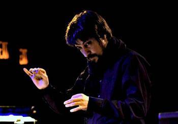 Composer and conductor Filippo Perocco conducting L'arsenale