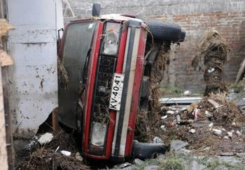 Some cars were turned onto their sides in Talcahuano, Biobio.