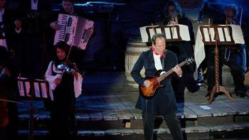 """Hans Zimmer is the composer of the music for """"Sherlock Holmes."""" Here, he plays guitar at the premiere of """"Pirates Of The Caribbean"""" in 2007."""