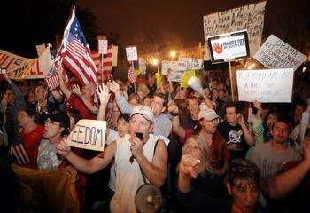 Protesters of the health care reform bill react to the passage of legislation in Washington, DC