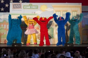 Cookie Monster, Zoe, Elmo, Grover and Rosita Onstage During a Performance for Military Families in Germany