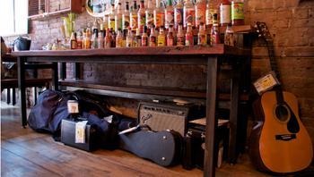 Donated instruments and the Bloody Mary bar at Rosamunde Sausage Grill in Brooklyn