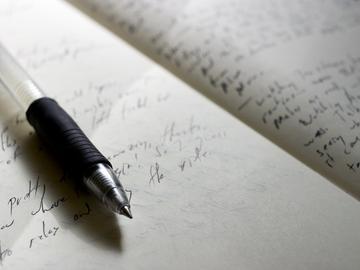 pen writing paper