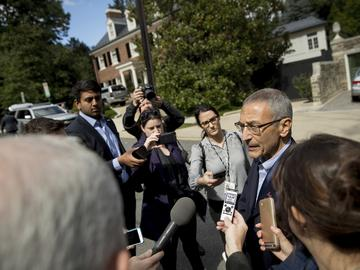 John Podesta, campaign manager for Democratic presidential candidate Hillary Clinton, talks to reporters outside Clinton's Washington home, Wednesday, Oct. 5, 2016.