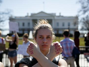 Gwendolyn Frantz, 17, of Kensington, Md., stands in front of the White House during a student protest for gun control.