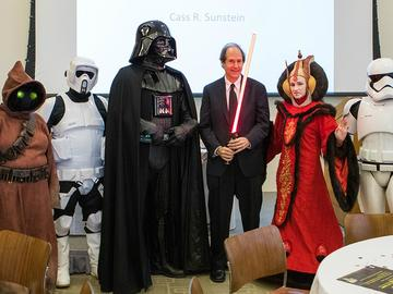 "Cass Sunstein posing with Harvard students dressed as ""Star Wars"" characters after a lecture"