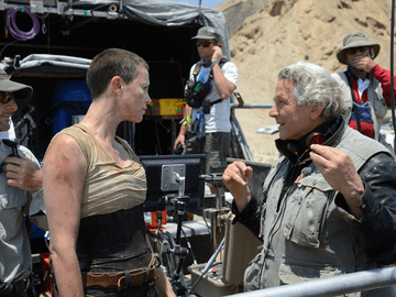 "George Miller with Charlize Theron on the set of ""Mad Max: Fury Road"""