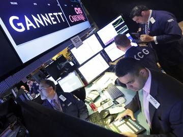 Gannett, on the floor of the New York Stock Exchange.