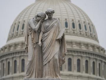 The U.S. Capitol Dome is seen behind the Peace Monument statue in Washington, Monday, Dec. 31, 2018.