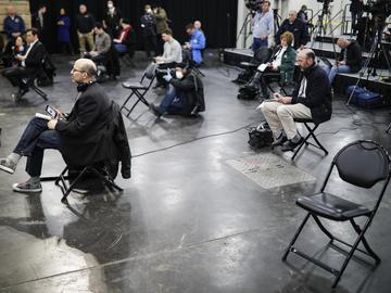 Journalists practice social distancing during a news conference with New York Gov. Andrew Cuomo in March, 2020.