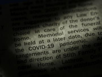 An obituary in the Kansas City Star newspaper details the effect of the COVID-19 pandemic on traditional funeral services, Sunday, April 5, 2020.