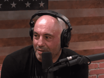 Joe Rogan interviews a guest on his podcast.