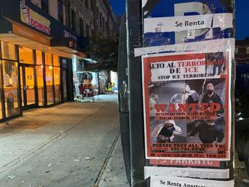 A flyer reading 'Stop ICE Terrorism' posted on the side of a parking meter in Sunset Park