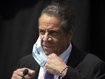 In this June 15, 2020, file photo, New York Gov. Andrew Cuomo removes a mask as he holds a news conference in Tarrytown, N.Y.