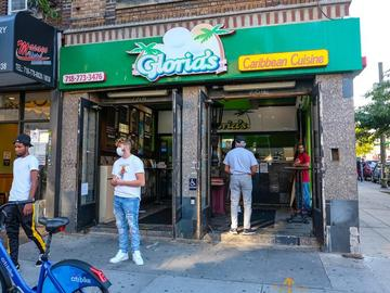 People stand outside Gloria's Caribbean Cuisine at 764 Nostrand Avenue