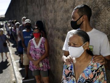 Seniors wait in line to get the Sinovac vaccine for COVID-19 at a health center in Brasilia, Brazil, Monday, March 29, 2021.