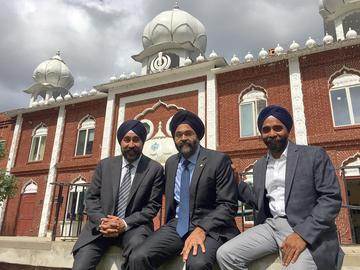 Bhalla, Grewal and Singh outside the Glen Rock Gurudwara, where they grew up.