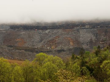 Surface mining operations are seen beneath low lying clouds in the Appalachian Mountains on April 18, 2012 in Partridge, Kentucky.