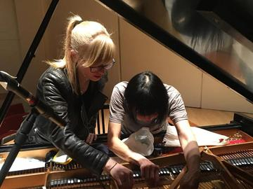 Composer/pianist Kelly Moran and pianist Margaret Leng Tan prepare the piano