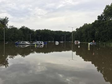 In a Saturday, Aug. 11, 2018 photo, a supermarket parking lot is flooded from rainfall in Little Falls, N.J.
