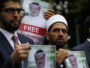 In this Monday, Oct. 8, 2018 file photo, members of the Turkish-Arab Journalist Association hold posters with photos of missing Saudi writer Jamal Khashoggi,