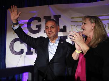 Democratic candidate for California's 39th Congressional District, Gil Cisneros, left, and wife, Jacki, acknowledge the supporters at an election night party Tuesday, Nov. 6, 2018, in Fullerton, Calif