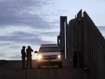 United States Border Patrol agents stand by a vehicle near one of the border walls separating Tijuana, Mexico and San Diego Wednesday, Nov. 21, 2018, in San Diego.