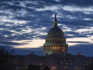 Dawn arrives at the Capitol in Washington, as the partial government shutdown enters day 18, Tuesday, Jan. 8, 2019