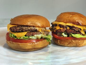 An Original Impossible Burger, left, and a Cali Burger, from Umami Burger, are shown in this photo in New York, Friday, May 3, 2019.