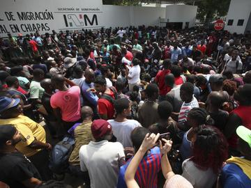 Migrants wait for a turn in line to solve their migratory situation, at an immigration center in Tapachula, Chiapas state, Mexico, Monday, May 27, 2019.