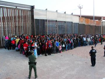 This May 29, 2019 file photo released by U.S. Customs and Border Protection (CBP) shows some of 1,036 migrants who crossed the U.S.-Mexico border in El Paso, Texas.
