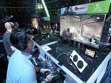 Gamers experience 'Gears 5' at the Xbox E3 2019 Showcase in the Microsoft Theater at L.A. Live, Sunday, June 9, 2019 in Los Angeles.