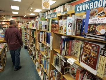 A man walks down the aisle past the cookbooks at a bookstore in a mall in Grove City, Pa., Friday, Sept. 5, 2008.