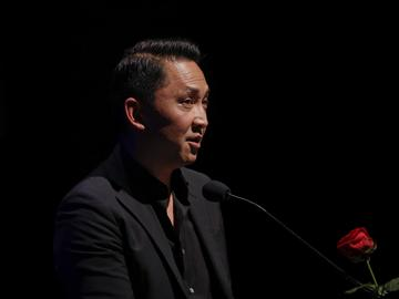 Vietnamese writer Viet Thanh Nguyen, 2016 storytelling Pulitzer prize winner, reads during the 'La Milanesiana' cultural event, in Milan Italy, Tuesday, July 11, 2017.