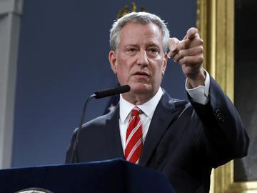 New York Mayor Bill de Blasio calls on a member of the press at City Hall