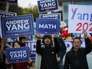 Supports of Democratic presidential candidate businessman Andrew Yang rally before the New Hampshire state Democratic Party convention, Saturday, Sept. 7, 2019, in Manchester, NH.