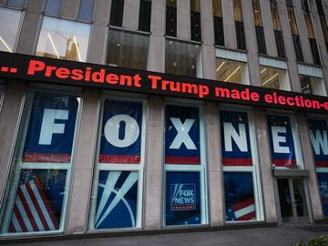 A headline about President Donald Trump is shown outside Fox News studios, Wednesday, Nov. 28, 2018, in New York.