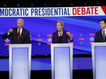 Democratic presidential candidate former Vice President Joe Biden, left, Sen. Elizabeth Warren, D-Mass., center and South Bend Mayor Pete Buttigieg speak during a Democratic presidential debate.